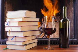 The-mediterranean-tastes-books-glass-and-a-bottle-of-red-wine